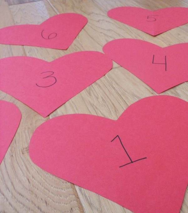 Valentine's Day is coming up... here's a great simple and fun Valentine game for toddlers. (It works little legs AND uses up a little playful energy! YAY!