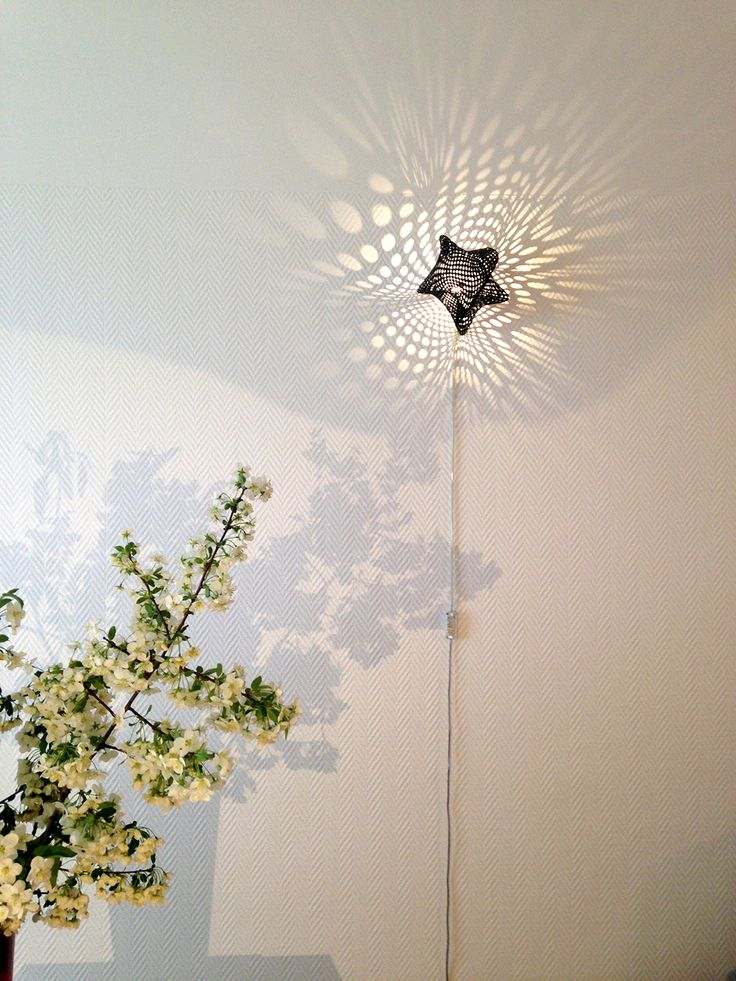 Starfish Light Sculptures are one of a kind 3D printed lamps by Ateljé Sotamaa. The Starfish light sculpture casts ephemeral 'light paintings' on wall surfaces. Each light sculpture and the spotted patterns it generates are unique. Its tentacles touch the wall lightly on three points, as if it was slowly crawling up the wall. The effect Starfish creates depends on the time of the day general illumination of the space - varying from delicate figures to sharp, expressive formations.
