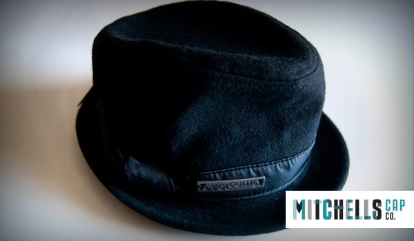 Wool Fedora hat with metal embossed branding. Comfy, dark and stylish.