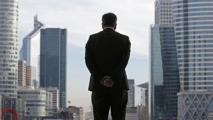 A Businessman is silhouetted as he stands under the Arche de la Defense, in the financial district west of Paris, November 20, 2012. France said its economy was sound and reforms were on track after credit ratings agency Moody's stripped it of the prized triple-A badge due to an uncertain fiscal and economic outlook. Monday's downgrade, which follows a cut by Standard & Poor's in January, was expected but is a blow to Socialist President Francois Hollande as he tries to fix France's finances…