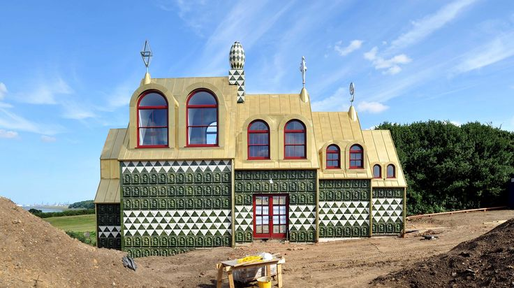"""Award winning artist Grayson Perry has designed a green and gold holiday cottage in Essex which has been nicknamed a """"gingerbread house"""""""