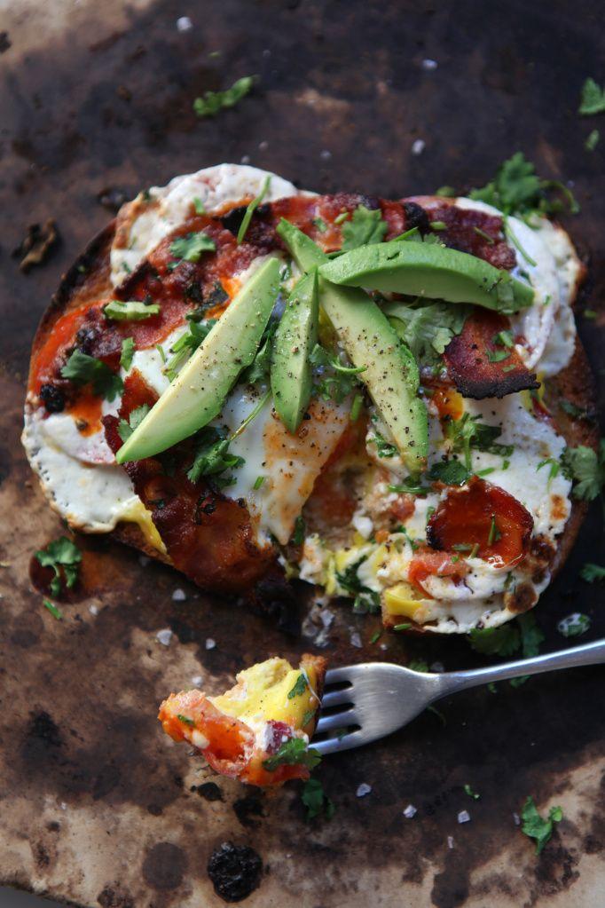 Breakfast Pizza by francesjanish: Made with tomato, mozzarella, egg, bacon, garnished with avocado and cilantro. #Pizza #Breakfast