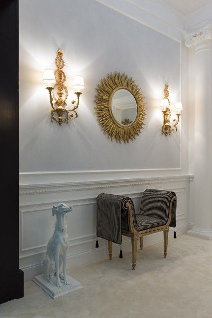 Beautiful interior featuring hand carved Italian style sunburst mirror with Adam style sconces in gold leaf finish, Neoclassic style bench