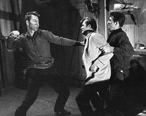 Richard Coogan, Roger Moore and John Zaccaro in a 1960 episode of Maverick