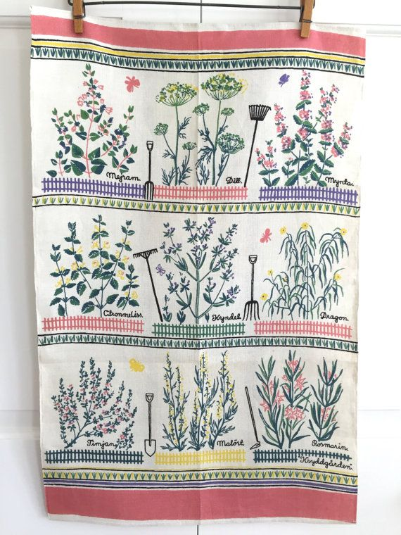 Vintage Swedish towel featuring colorful flowering herbs and multi-colored picket fences.