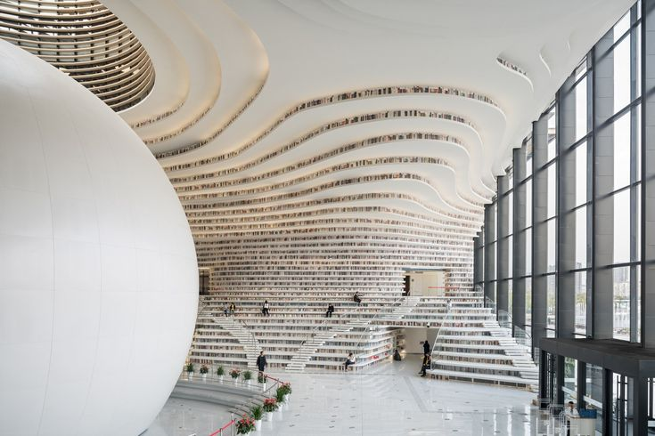 The newly opened Tianjin Binhai Library is designed by a Rotterdam based architectural firm MVRDV, in collaboration with Chinese local architects from TUPDI (Tianjin Urban Planning and Design Institute). The library is a 33,700? cultural centre, featuring a luminous spherical atrium with bookshelves lining the walls, from floor to ceiling. The five-story space resembles a …