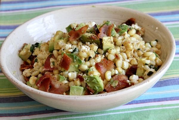 BACON AVOCADO CORN SALAD  5 strips thick-cut bacon  4 large ears corn, husks and silks removed  1/2 cup crumbled feta or cotija cheese  2 tablespoons chopped fresh cilantro  juice of 1 lime  1 large Hass avocado  coarse salt and freshly ground pepper, to taste