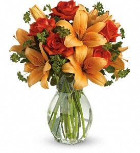 A mix of red/orange lilies and white roses for the ceremony?