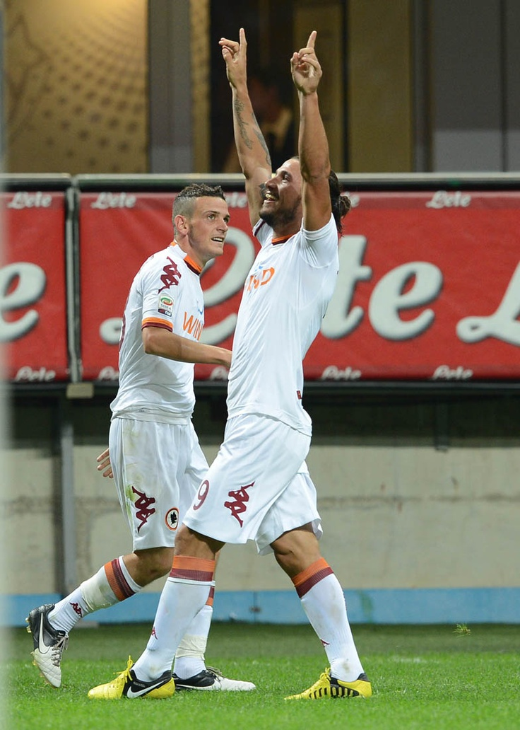 Osvaldo celebrates after skilfully lifting a ball over the goalkeeper and in to the net on a brilliant pass from Totti to put Roma ahead for good. INTER v. ROMA (1-3) Sep 2, 2012