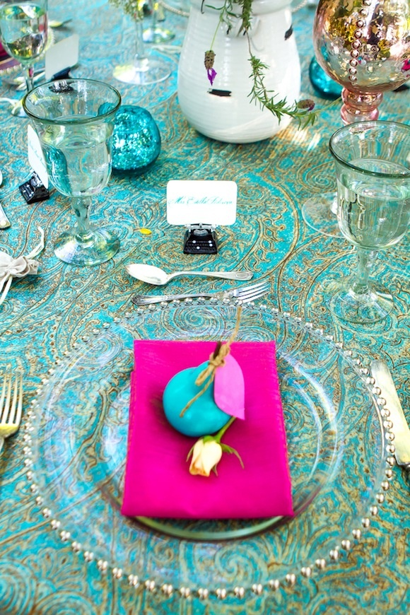 Teal Wedding Shoot Inspiration - blue pears, vintage flatware, sea green wine glasses, hot pink napkins, roses, and paisley tablecloth.