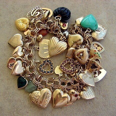 Vintage heart charms and locket. I'm gathering up to make one very similar to this because I just love hearts. Love the few really blue stones.