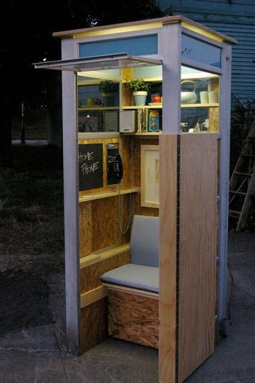 phonebooth home.  the bench folds out into a bed....