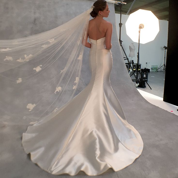 The stunning fishtail gown 'Amore' by Anna Sorrano  Get the look with the  beautiful 'Alexandra' jacket by Amixi