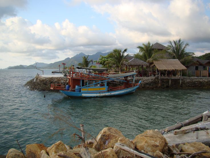 A very colorful fishing boat off the coast of kai bae beach on koh chang island, thailand.