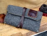 A grey flannel and brown leather trimmed pipe and tobacco pouch, from etsy shop: www.sorringowlandsons.etsy.com