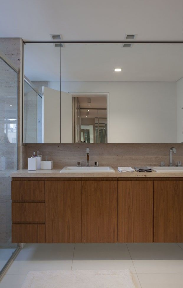 Apartamento tem uso extensivo da madeira - Casa Vogue | Apartamentos