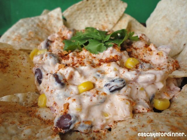 Fiesta Dip: cream cheese, sour cream, sweet yellow and white corn, black beans, diced tomatoes with green chiles, salsa seasoning mix (or taco seasoning), shredded sharp Cheddar cheese