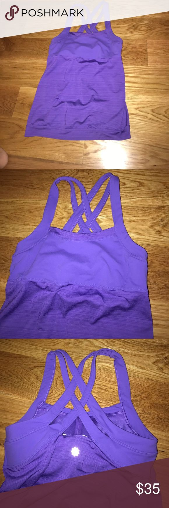 Athleta Crunch & Punch Tank Excellent very gently used condition Athleta Crunch and Punch Tank. Full support built in bra. Size Medium but can fit a Small with a bigger bust. Fitted top with blousy banded bottom. A great workout wardrobe staple. Purple Athleta Tops Tank Tops