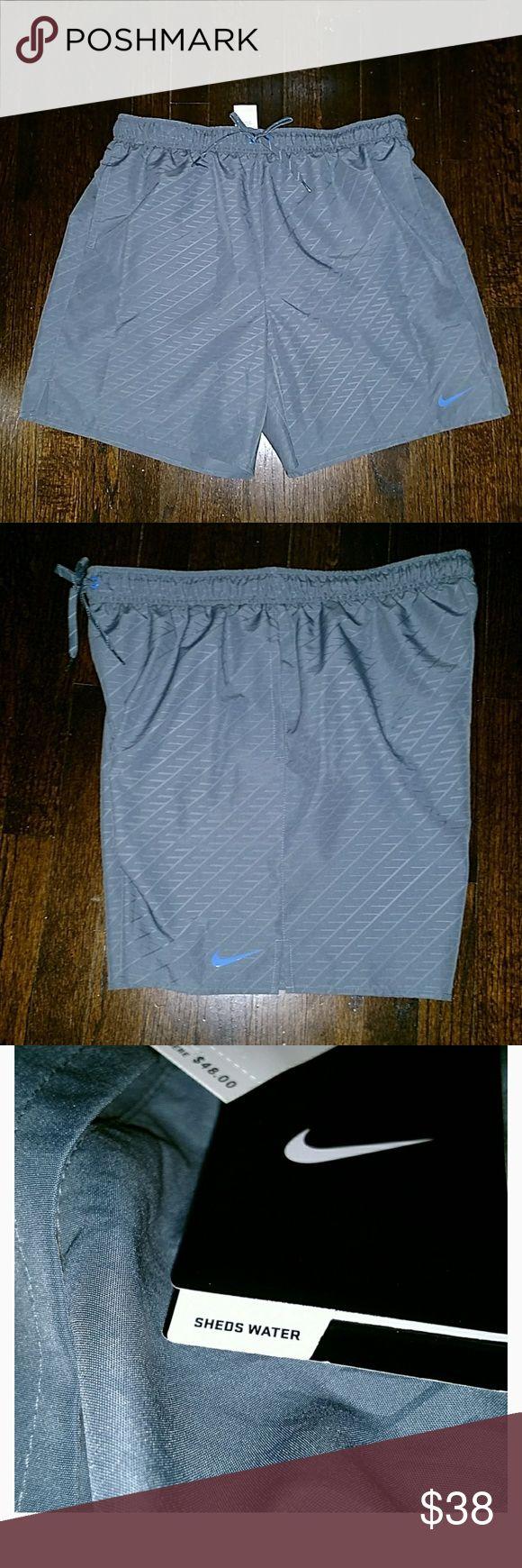 Nike Swim Shorts Blue swim shorts with funtional pockets. Adjustable string waist. New never worn. Nike Swim