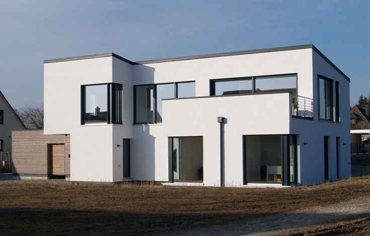 Einfamilienhaus modern holzhaus flachdach garage mit for Haus flachdach