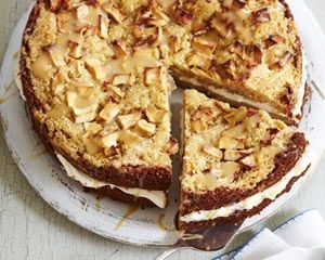 James Martin's apple crumble cake recipe is filled with whipped cream and topped with crumble and a drizzle of fudge