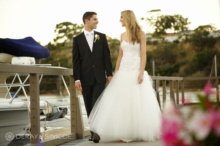 Romantic bride and groom walking along the jetty. Wedding reception styling, ideas and inspiration.  Reception Venue: Mosman's Restaurant  Photography by DeRay & Simcoe