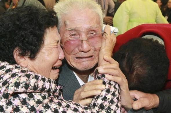 North Korean Kim Jin-Won (C), 80, cries as he bids farewell to his South Korean relatives after their inter-Korean temporary family reunions at Mount Kumgang resort November 1, 2010. Four hundred and thirty-six South Koreans visited the North for three days, to meet their 97 North Korean relatives, whom they have been separated from since the 1950-53 war.