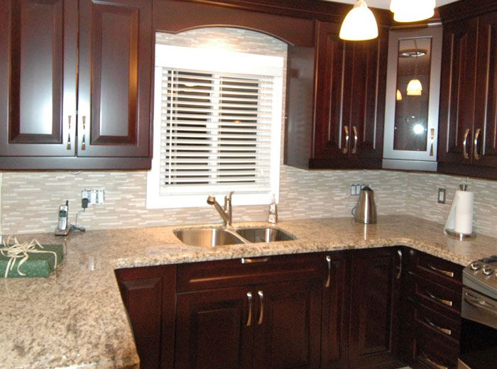Custom kitchen cabinets stained in red mahogany with decorative ...