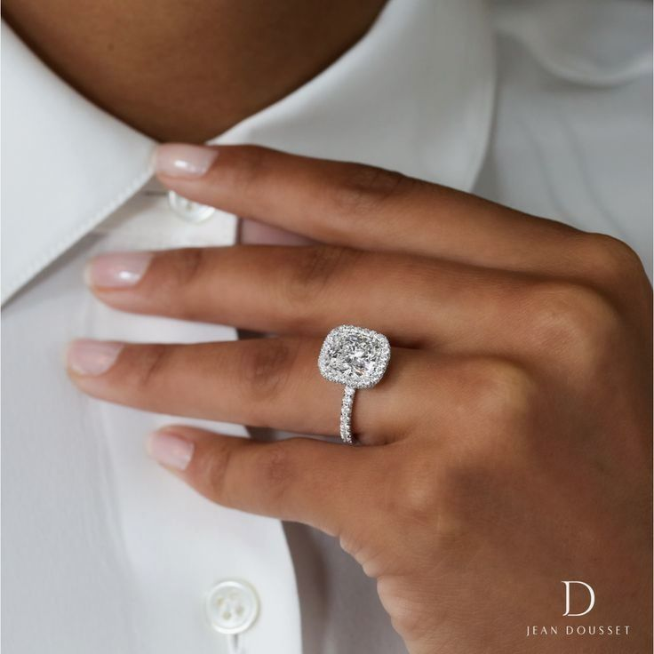 The EVA SEAMLESS HALO design set with 2.50 carats cushion cut diamond engagement ring. Jean Dousset's Seamless Halo designs are handcrafted around the precise measurement of the center stone without prongs, highlighting the true beauty of the diamond.