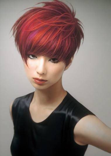 .red short hairstyle with violet highlights and messy lifted back