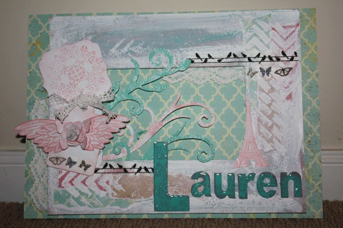 An A4 size chipboard name plaque. I have used Kaszazz products - papers, chipboard photo frame and letters, paint dabbers, washi tape, stamps, gesso