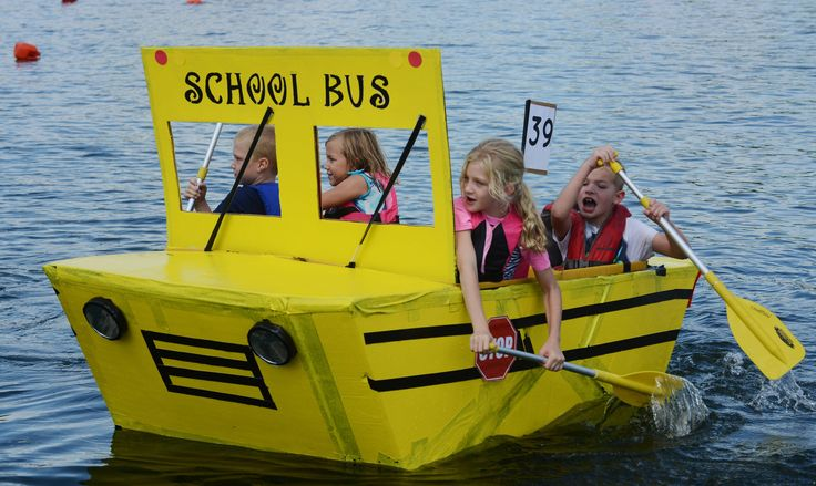 Left to right, Brian Hart, 7, Lexi Rininger, 10, Johanna Hart, 8, and Thomas Thompson, 8, all of Volo guide Bus 55 back to shore during the 15th annual Labor Day Cardboard boat Races at Lindy's Landing in Wauconda Saturday.