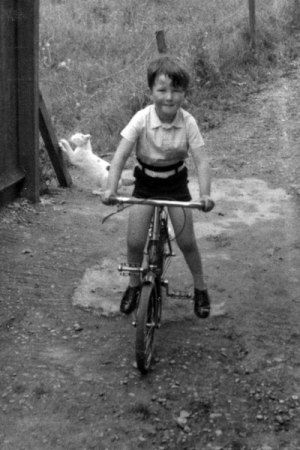 small boy on a bike: Thomas Donaldson 1941, aged 5 in WWII