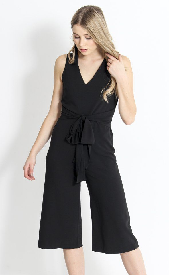 V Neck Front Tie Jumpsuit | This jumpsuit is the perfectly cool evening alternative to a dress - the midi leg and cinching waist tie elongate the figure, while a classic V neckline compliments the fit. Add heels and jewellery to complete a look that suits any evening occasion.