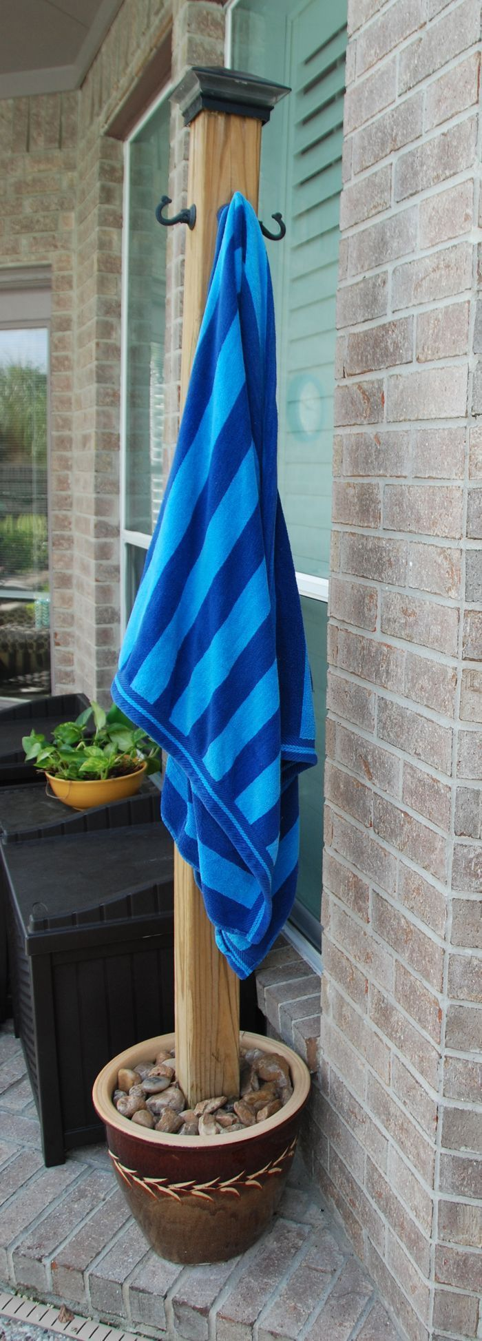DIY Pool Towel Holder - We made this stand to hang our wet pool towels to dry after swimming!  ~ Great pin! For Oahu architectural design visit http://ownerbuiltdesign.com