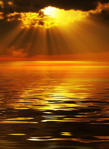 The Golden Sun shinning through the clouds onto the beautiful ocean. How much more beautiful can this get!!