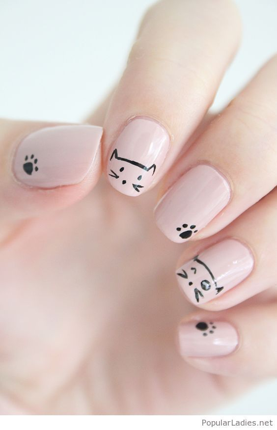 Nude nails with cat print