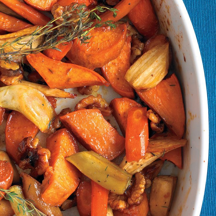 Honey glazes this simple side dish of roasted sweet potatoes, carrots, and parsnips with sweetness and sheen. Walnut halves and thyme sprigs roast along with the vegetables for additional fall flavor.