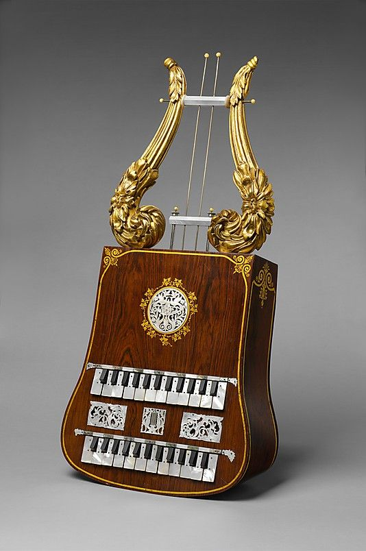 "1848-1852 American(?) Apollo lyre at the Metropolitan Museum of Art, New York - It's interesting to see, looking back over the years, just how much experimentation went on in creating the musical instruments we know today.  For instance, this is the only known ""Apollo lyre"" in existence - according to the curators, ""The upward-pointing handles produce pressure and suction to sound a diatonic scale, as in an accordion or harmonica."""