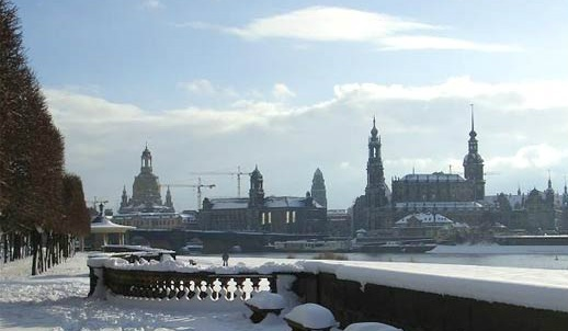 Dresden in Saxony, Germany. Once known as the 'Florence of the Elbe'. A winter view over the Elbe river. On the right is the Semper Oper, opera house, on the left is the dome of the Frauenkirche. Dresden was a city of ruins after a massive WWII air raid by the Allies which began February 13th, 1945. Since German reunification in 1990 restoration work has helped reconstruct parts of the historic inner city, including the Semper Oper and the Frauenkirche.