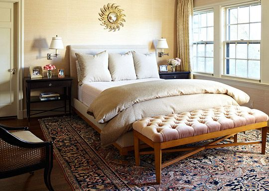 love the tufted bench the oriental rug mixed with the more contemporary furniture is cool