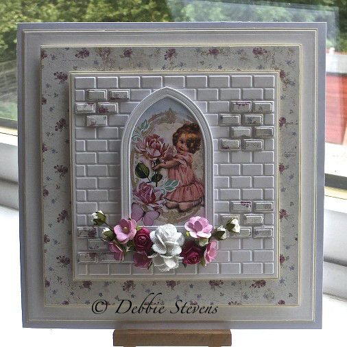 Spellbinders grand squares, memory box gothic small window, flowers from sweet lilac flowers, picture from Etsy, paper from Live and love crafts. DF3403 wall and brick set by Marianne designs. Made by Debbie Stevens