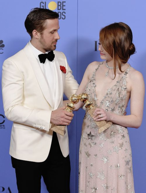 """Ryan Gosling and Emma Stone, winners for Best Actor and Best Actress in a Musical or Comedy Film for 'La La Land', pose in the press room during the 74th Annual Golden Globe Awards at The Beverly Hilton Hotel on January 8, 2017 in..."