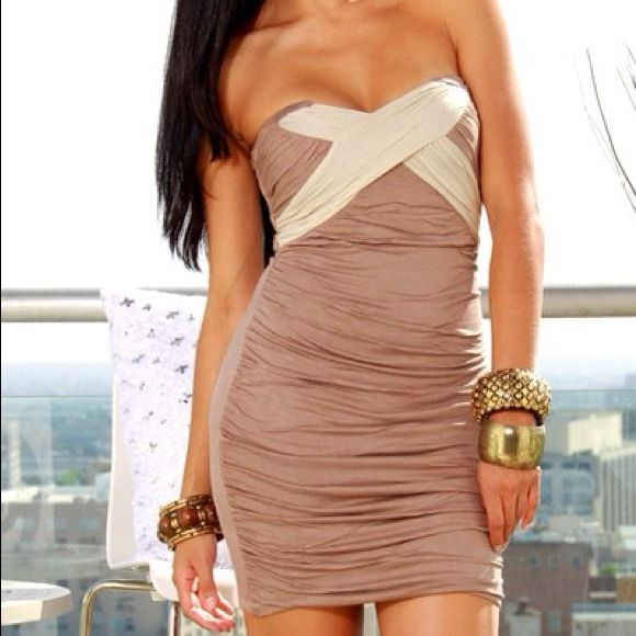 #45c - Brown with White Tube Dress Fabulously sexy and so easy to wear, this clubbing mini dress is both casual and dressed up. Sweetheart neckline with cream cross effect highlights bust line, while soft mocha skirt makes your curves kick!! Make this your new go-to dress. 95% Cotton 5% Elastane Dresses