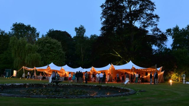 Stretch tent with festoon lighting. #stretchtent #alternativemarquee #event #weddingvenue #eleganttent #moderntent #modernmarquee #lightinghire #Freestretch