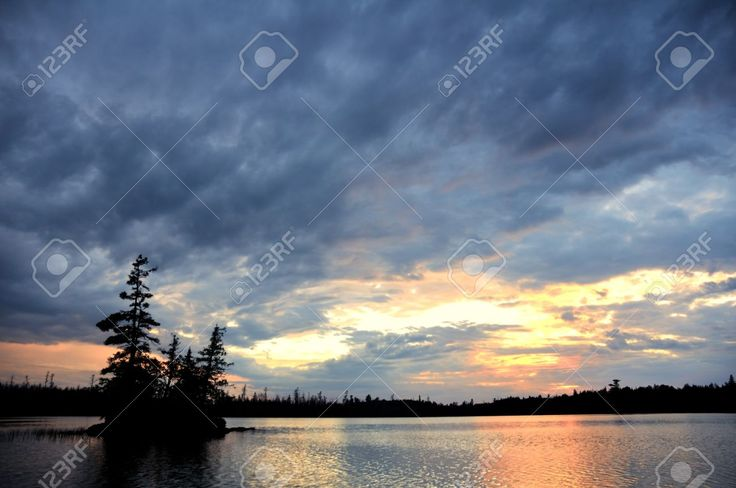 Scenic Island On A Remote Wilderness Lake With Dramatic Sky At ...
