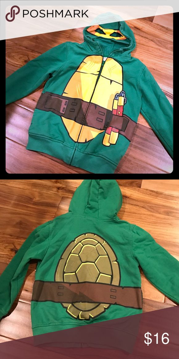 Nickelodeon Ninja Turtles Mask Hoodie size 8 Most amazing Ninja Turtles hoodie ever!  I had to hunt this thing down for my son!  Eye mask is attached to the hood.  Graphics on front and back.  Excellent condition, worn a handful of times...we live in Florida so our winter items don't see much use. Nickelodeon Shirts & Tops Sweatshirts & Hoodies