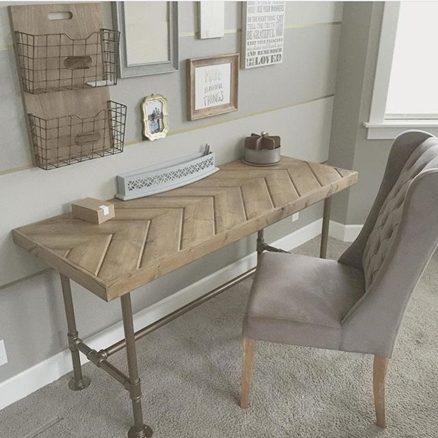 My hubby & I designed and built this desk together. Pipe desk with herringbone top.                                                                                                                                                                                 More