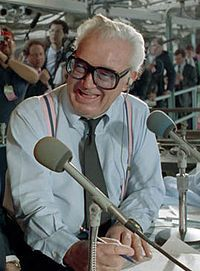 Harry Caray.  Years ago, my mother worked for the Golf Mill State Bank and they did a promotion with radio station WQKX and Mr. Caray was at the bank as part of the promotion. I also  got to take picture with Mr. Caray.
