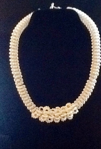 This is a beautiful beaded coiling necklace by Josie Fashion Jewelry $60.00